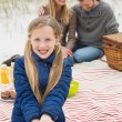 Happy family of three at a beach picnic — Stock Photo
