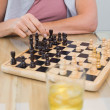 Mid section of a woman and man playing chess — Stock Photo