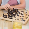 Mid section of womand mplaying chess — Stock Photo #38988495