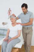 Senior woman getting the neck adjustment done — Stock Photo