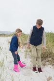 Full length of siblings at beach — Stock Photo