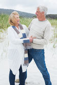 Cheerful romantic senior couple at beach — Stock Photo