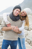 Happy romantic couple together on rocky landscape — Stock Photo