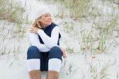 Senior woman with eyes closed at beach — Stock Photo