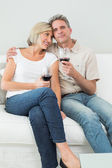 Relaxed couple with wine glasses at home — Stock Photo