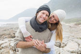 Romantic couple standing together on rocky landscape — Stock Photo