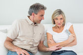 Serious couple watching tv at home — Stock Photo