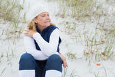 Senior woman with eyes closed at beach — Stock Photo