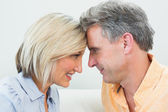 Close-up side view of a happy loving couple — Stock Photo