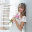 Portrait of a beautiful young woman with flowers — Stock Photo #42589735