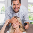 Smiling man surprising woman with a wedding ring at home — Stock Photo
