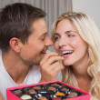 Relaxed happy couple eating candies — Foto de Stock