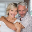 Mature man embracing a happy woman — Stock Photo