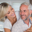 Close-up of a happy woman embracing mature man — Stock Photo