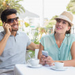Couple with mobile phones at coffee shop — Stockfoto