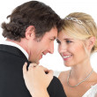 Bride and groom embracing over white background — Stock Photo #42585465
