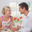 Happy young couple with wine glasses having food — Stock Photo #42585799
