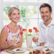 Happy young couple with wine glasses having food — Stock Photo #42585995