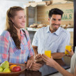 Waitress giving orange juice to a couple at coffee shop — Stock Photo #42586591