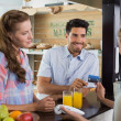 Couple paying bill at coffee shop using card bill — Stock Photo #42586825