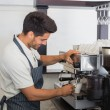 Waiter making cup of coffee at coffee shop — Stock Photo