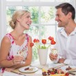 Happy young couple with wine glasses having food — Stock Photo #42587213