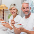 Mature couple having breakfast in bed — Stock Photo #42587553