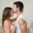 Loving young man kissing woman on forehead — Stock Photo #42589191