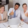 Business people gesturing thumbs up — Stock Photo