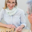 Couple playing chess at home — Stock Photo #42589837