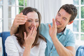 Close-up of a man surprising woman in living room — Stock Photo