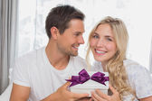 Portrait of a beautiful blonde receiving a gift box — Stock Photo