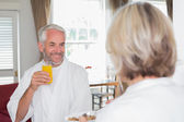 Smiling mature man having breakfast with cropped woman — Stok fotoğraf