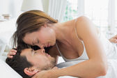 Relaxed young couple together in bed — Stock Photo