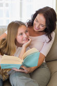 Mother and daughter with story book — Stock Photo