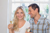 Portrait of a loving couple with wine glasses — Stock Photo