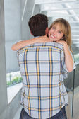Loving young woman embracing man — Stock Photo