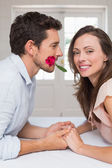 Loving young couple holding hands at home — Stock Photo