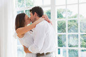 Side view of a loving couple kissing — Stock Photo