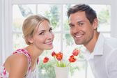 Portrait of a romantic young couple smiling — Stock Photo