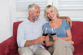 Happy relaxed mature couple toasting wine glasses — Stock Photo