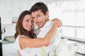 Loving young couple embracing at home — Stock Photo