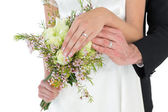 Bride and groom showing wedding rings — Stock Photo