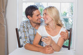 Loving couple reading text message together at home — Stock Photo