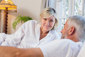 Mature couple lying in bed — Stock Photo