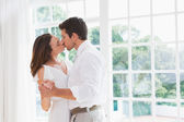 Loving young couple kissing — Stockfoto