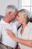 Relaxed mature couple with head to head and eyes closed — Stock Photo