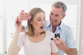 Man surprising happy woman with a wedding ring — Stock Photo