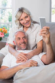 Mature couple photographing themselves with cellphone — Stock Photo