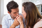 Loving man kissing womans hand at home — Stock Photo